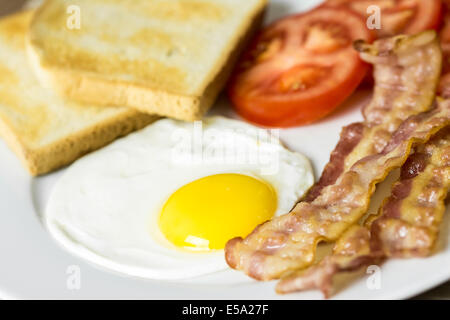 Tasty English Breakfast With Fried Egg, Bacon, Toast And Tomatoes Close Up - Stock Photo