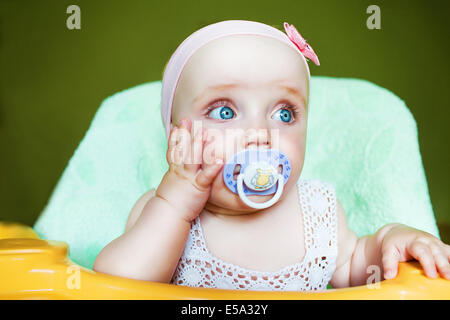 little cute child with baby's dummy in mouth