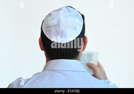 Jewish man with kippah pray isolated on white background. Concept photo Judaism ,religion belief, faith, lifestyle - Stock Photo