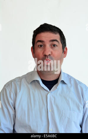 Man surprised face expression. Male emotional expression on white background. Concept photo of astonish,surprise, - Stock Photo