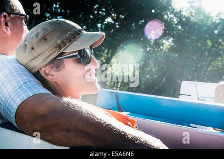 Couple relaxing in boat - Stock Photo