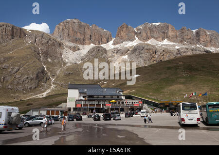 Parking at a cable car station at Pass Pordoi in the Italian Dolomites - Stock Photo