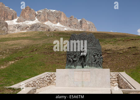 The monument to cyclist Fausto Coppi at the summit of the Pordoi Pass in the Italian Dolomites - Stock Photo