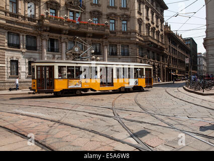 A yellow tram in Milan - Stock Photo