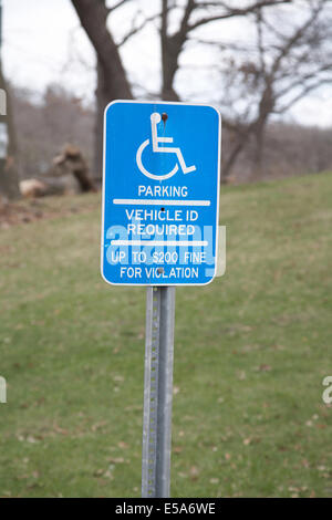 An American disabled parking sign in Minneapolis, Minnesota, USA. - Stock Photo