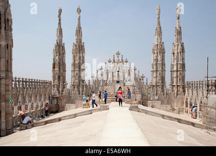 Tourists on the roof terraces of the Doumo in Milan, Italy - Stock Photo