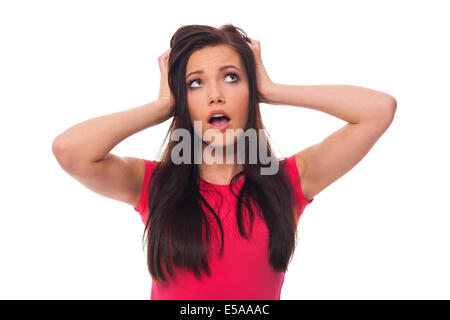 Young woman looking surprised on white background, Debica, Poland - Stock Photo
