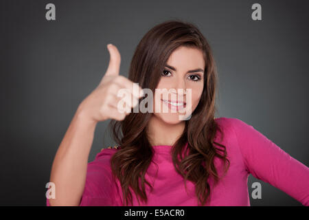 Woman holding her thumb up, Debica, Poland - Stock Photo