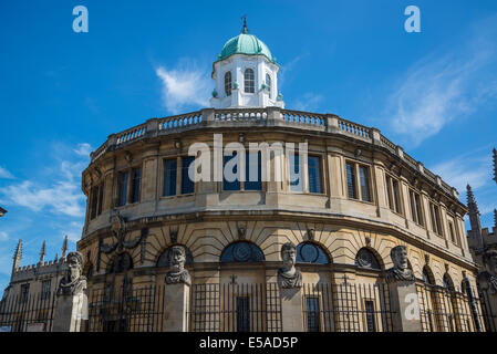 Sheldonian Theatre and Emperors Heads stone sculptures, Broad Street, Oxford, England, UK - Stock Photo