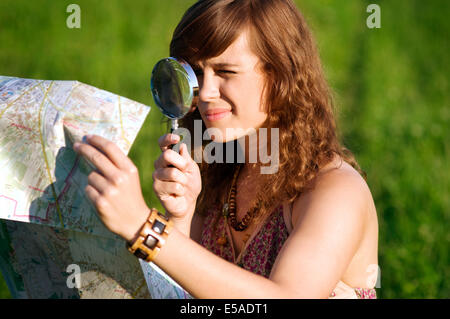 Beauty woman looking through magnifying glass, Debica, Poland - Stock Photo