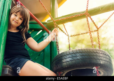 Portrait of happy, little girl on playground, Debica, Poland - Stock Photo