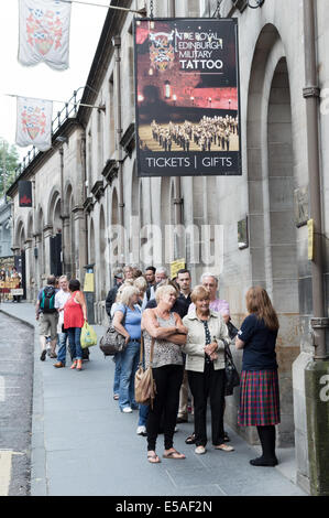 Tourists queueing for tickets for the Royal Edinburgh Military Tattoo - Stock Photo