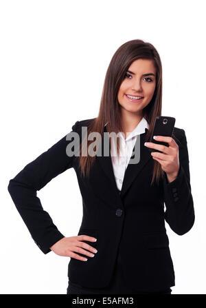 Happy businesswoman using smart phone, Debica, Poland - Stock Photo