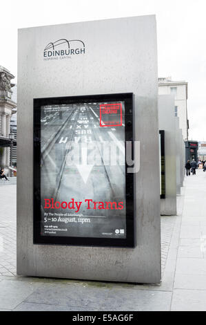 Billboard poster on Lothian Road advertising the Bloody Trams theatre production at the Traverse Theatre Edinburgh - Stock Photo