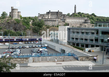St Andrews House Scottish Government buildings with Edinburgh Council offices and Waverley Train Station car park - Stock Photo