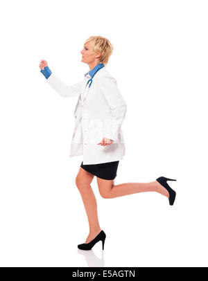 Female doctor running for her patients, Debica, Poland. - Stock Photo