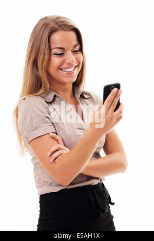 Cheerful businesswoman texting on mobile phone, Debica, Poland - Stock Photo
