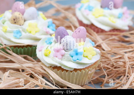 three decorated easter celebration cupcakes - Stock Photo