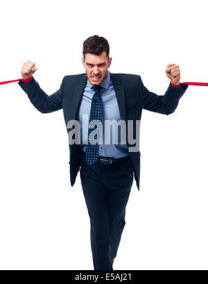 Angry businessman trying to release, Debica, Poland - Stock Photo