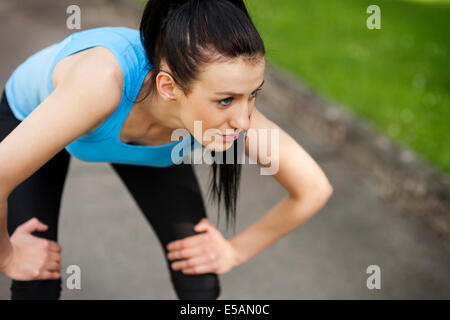 Tired woman after jogging, Debica, Poland - Stock Photo