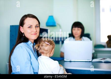 Mother and daughter with doctor in hospital, Debica, Poland - Stock Photo