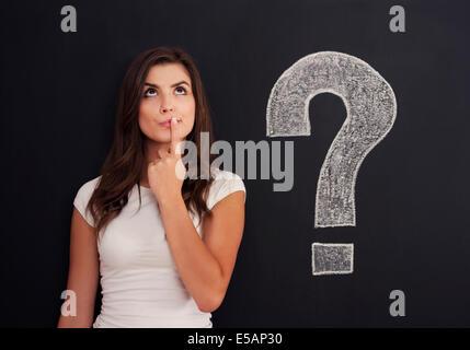 Woman with question mark on blackboard Debica, Poland - Stock Photo
