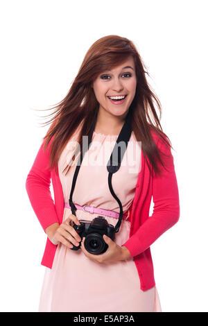Attractive young woman holding digital camera, Debica, Poland - Stock Photo