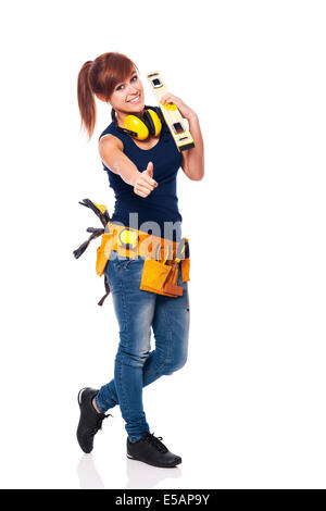 Young female construction worker showing OK sign, Debica, Poland - Stock Photo