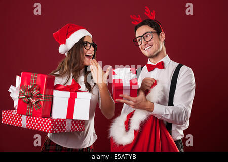 Nerd couple exchanging Christmas gifts Debica, Poland - Stock Photo