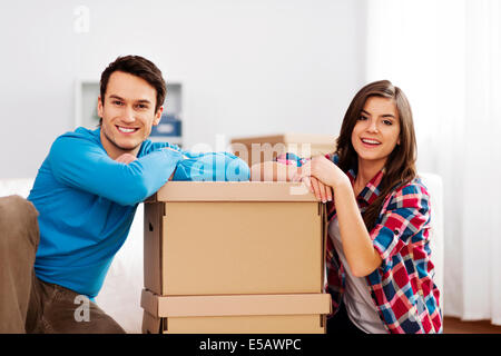 Portrait of young couple with moving boxes Debica, Poland - Stock Photo