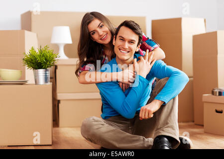 Portrait of happy couple in new home  Debica, Poland - Stock Photo