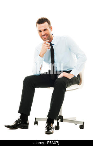 Successful businessman sitting on chair Debica, Poland - Stock Photo