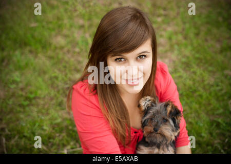 Young woman holding Yorkshire terrier Debica, Poland - Stock Photo