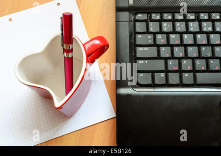 Love internet concept pen and glass - Stock Photo