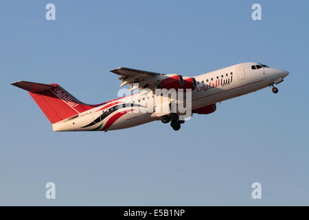 Avro RJ100 regional jet of Air Libya on departure against a blue sky - Stock Photo