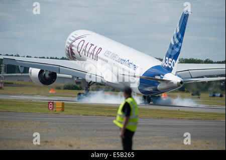 Airbus A350 XWB landing after a flight demonstration at the Farnborough International Airshow 2014 - Stock Photo
