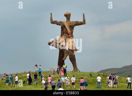 Dumfries, Scotland, UK. 25th July, 2014. Festival goers gather under the Wickerman on day two at Dundrennan on July - Stock Photo