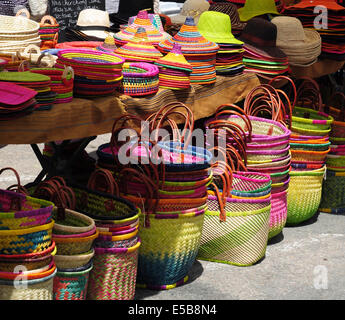 Hats and bags on market stall, Saint-Girons, Ariege, Midi-Pyrenees, France - Stock Photo