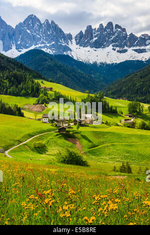 The Odle mountain peaks and the church of Santa Maddalena are the symbols of the Val di Funes - Stock Photo