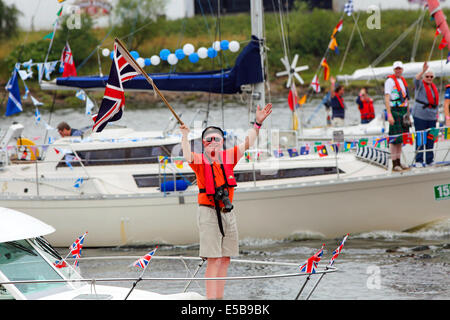 Glasgow, Scotland, UK. 26th July, 2014. A flotilla of about 250 small yachts and boats set sail from James Watt - Stock Photo