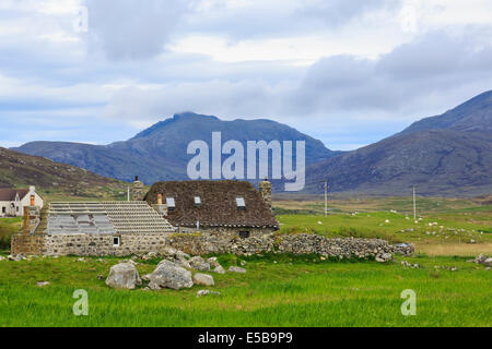 Old Blackhouses being restored for habitation as holiday homes. Howmore South Uist Outer Hebrides Western Isles - Stock Photo