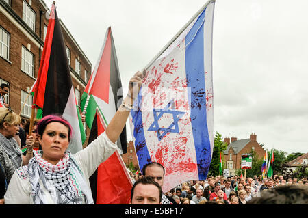 Belfast, Northern Ireland. 26 Jul 2014 - A young lady waves an Israeli flag which has red handprints on it symbolising - Stock Photo
