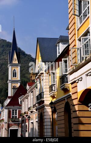 BAI LU / SICHUAN, CHINA:   View along a small street lined by Alsatian style buildings in the Sino-French village - Stock Photo