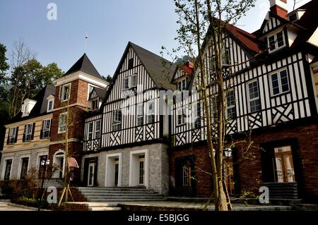 BAI LU TOWN, CHINA:  A row of half-timbered and stucco medieval-style buildings - Stock Photo
