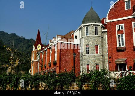 BAI LU / SICHUAN, CHINA:  Handsome brick and stone French-style buildings in the Sino-French Village - Stock Photo