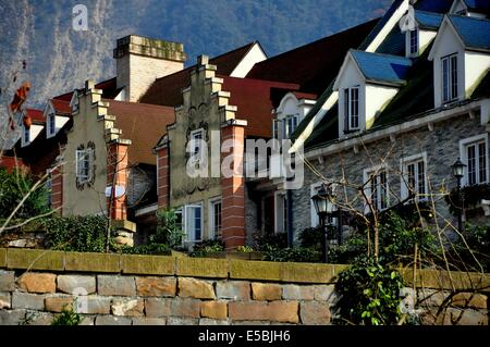 BAI LU / SICHUAN, CHINA:    Alsatian style houses with dormers, steeply pitched roofs, wide chimneys, and stepped - Stock Photo
