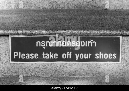 'Please take off your shoes' sign in Thailand - Stock Photo