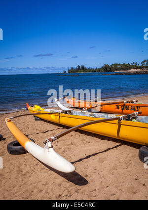 Outrigger canoes on beach on North Shore of Oahu, Hawaii - Stock Photo