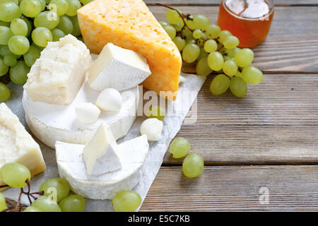 assortment of cheeses on the boards, food closeup - Stock Photo