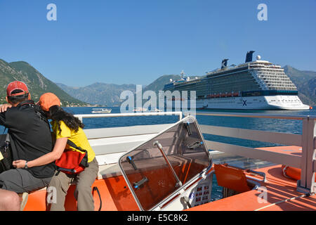 Cruise passengers on board lifeboat tender leaving 'Celebrity Silhouette' in the Bay of Kotor for short journey - Stock Photo